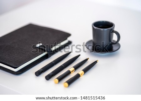 Desk setup with notebook pens and coffee with copy and mockup space