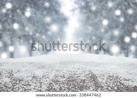 desk space and winter background of landscape white xmas snow for product presentation.