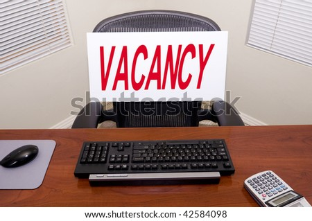 Desk with a Vacancy sign.