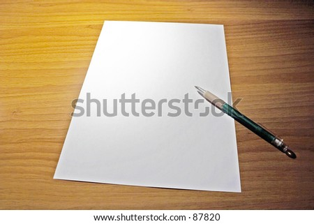 desk with empty paper - stock photo