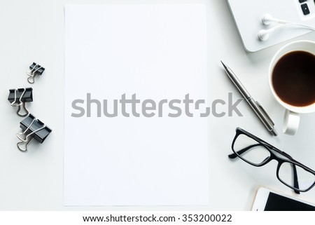 Desk with laptop, smart phone, coffee and supplies, top view. The blank paper can be used to put some text or images. #353200022