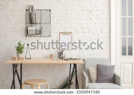 Desk with stationery in the white interior Loft workspace