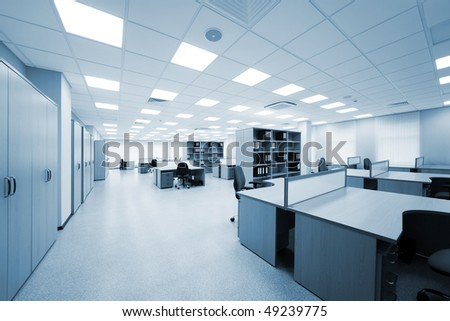 desks and bookcases in the modern office - stock photo