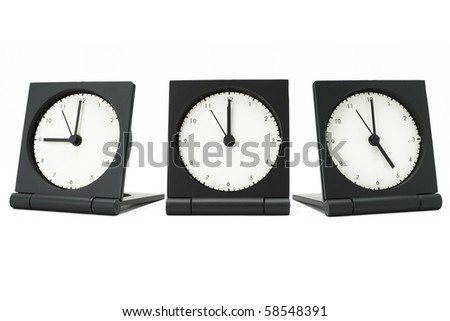 Desktop alarm clocks showing 9 am to 5 pm on white background