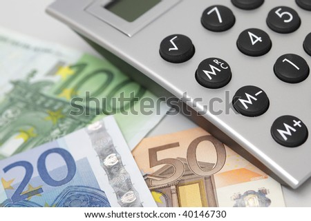 desktop calculator, closeup with euro currency