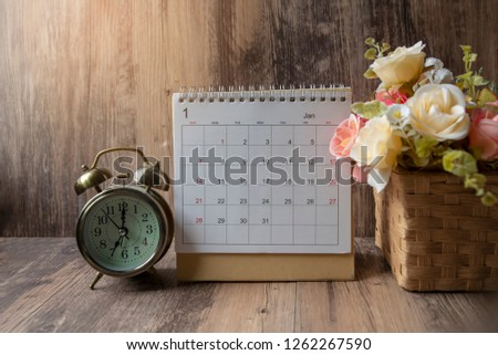 Desktop Calendar 2019 place on wooden office desk.Calender and clock for Planner timetable,agenda appointment,organization,management each date,month, year on office, table.Calendar Background Concept