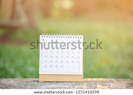 Desktop Calendar 2019 place on wooden office desk.Calender and notebook for Planner timetable,agenda appointment,organization,management each date,month and year on table.Calendar Background Concept.