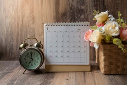Desktop Calendar 2020 place on wooden office desk. Calender for Planner to plan timetable agenda appointment organization and management job on table, work from home. Calendar Background Concept.
