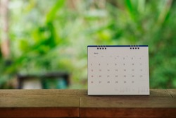 Desktop Calendar 2019 place on wooden office desk,green nature background.Calender for Planner timetable,agenda appointment,organization,management each date,month and year on table.Calendar Concept