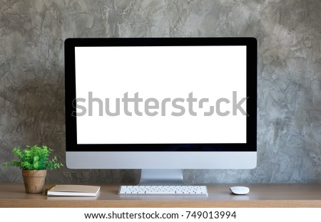 Desktop computer on work desk with blank screen