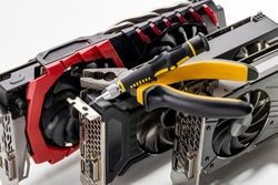 desktop hardware repair concept. tools for repair and variation of modern gpu or graphics cards on a background. hardware support conceptual.