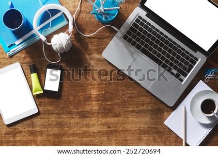 Desktop mock up with laptop, digital tablet, smartphone and stationery
