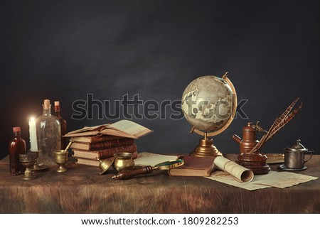 Desktop of a scientist, writer, or student of past centuries. Vintage items, books and manuscripts on a dark background. Space for your text. Photo stock ©