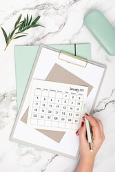 Desktop with calendar for january 2021 and office supplies. home office, social media blog, schedule, planning concept. Flatlay, top view