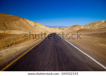 Desolate desert road in Death Valley National Park, California