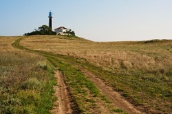 Desolate road to the lighthouse with a house.