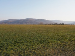 Desolate Silesian Beskid Mountains range in european Bielsko-Biala city in Poland, clear blue sky in 2020 warm sunny spring day on April.
