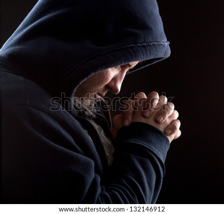 Despair bandit praying God for forgiveness