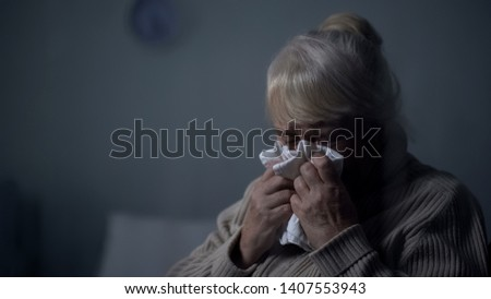 Desperate elderly female deeply crying in dark room, hospice loneliness, problem #1407553943