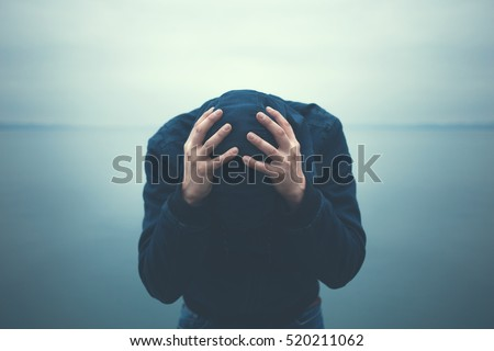 desperate man holding head with hands