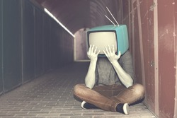 desperate man with television on his head