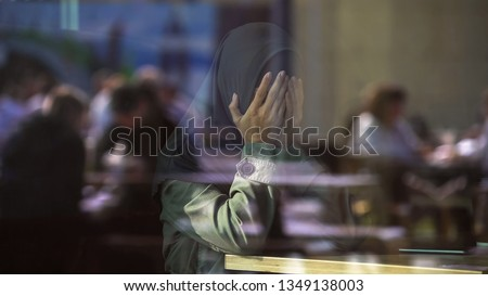 Desperate Muslim female crying in cafe, covering face with hands, loneliness #1349138003