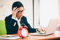 Desperate senior businessman being close to ruin - clock showing five minutes to twelve. Business woman tired of working in the office.