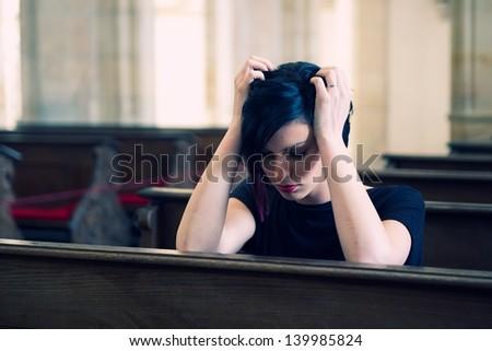 Desperate woman in the church