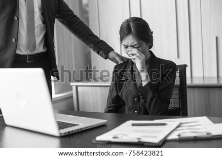 Desperate young Asian businesswoman unable to work with stress situation, suffering stress, boss come to order many job to her, Black and White Tone. Stock photo ©