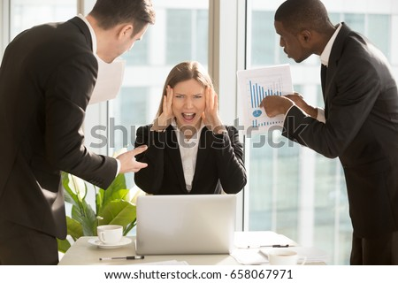 Desperate young businesswoman unable to cope with too much work, suffering stress, overworked employee looking at camera and screaming, multitasking female boss missing deadline, nervous breakdown Stock photo ©