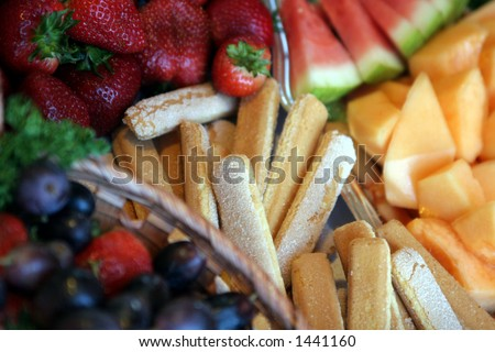 Dessert bar with fruit and wafers.