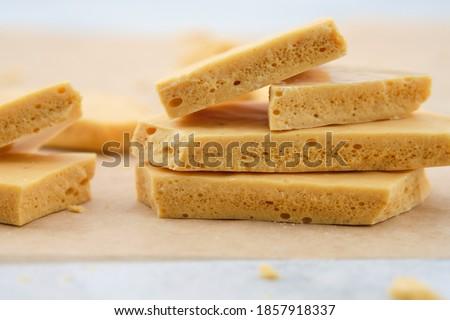 Dessert caramel honeycomb toffee on a white background. Stockfoto ©