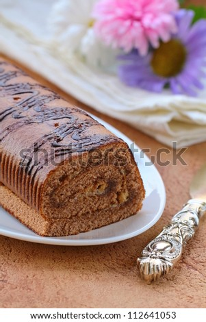 dessert chocolate biscuit roll on a plate