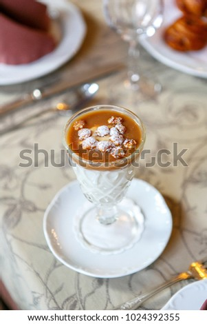 Dessert in a glass on a serving table. Serving dishes in a restaurant, cafe. Beautiful decoration of food. Close up. View from above. Single #1024392355