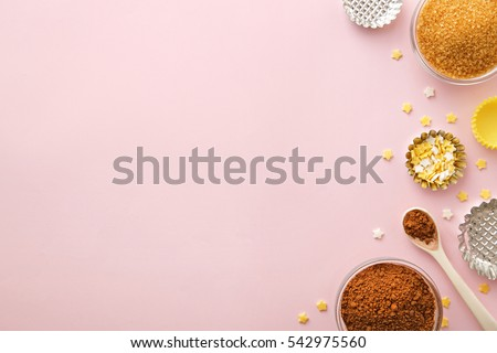Dessert ingredients and utensils with pink copy space. Top view