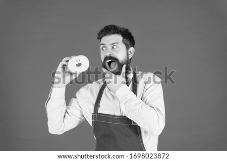 Dessert made with passion. Professional baker enjoy baking doughnut dessert. Bearded man having fun with sweet baked pastry dessert. The best dessert under the sky.