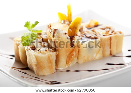 Dessert Maki Sushi - Roll with Various Fruit and Cream Cheese inside. Pancake outside. Served with Chocolate Sauce
