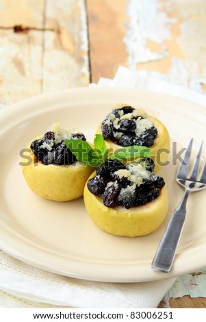 dessert of baked apple with raisins and sugar