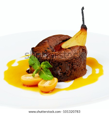 Dessert of baked pear with bisquit and fruit sauce