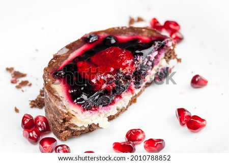 dessert of baked tartlets, chocolate tartlet with fruit and berry filling, round tartlet with strawberries and blueberries in butter cream