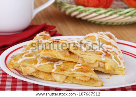 Dessert of two apple turnovers on a plate