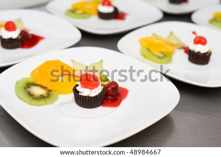 dessert on plates in restaurant kitchen ready for serving up