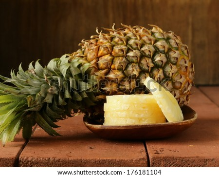 dessert pineapple sliced on a wooden plate