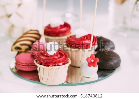 Dessert Sweet Tasty Cupcakes, Macarons And Cookies In Candy Bar On Table. Delicious Sweet Buffet. Wedding Holiday Decorations #516743812