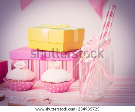 dessert table and presents at girls pink party