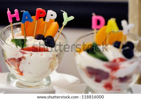 "dessert with candles with the words ""Happy day"""