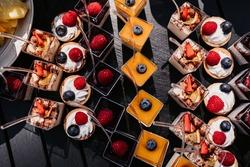 Desserts, snacks, quick dessert, small sweets, fruits, raspberries, strawberries, starfruit, cream, marshmallows, mango, mousse dessert, pineapple, blackberry, buffet and service, outdoor service.