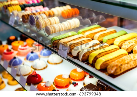 Desserts, sweets and treats counter in the pastry shop.  #693799348