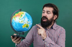 destination place. male student sit in classroom while lesson. pass the exam. learning the subject. back to school. happy teachers day. man with beard hold geography globe map. informal education.