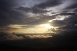 Destination twilight and paradise of golden sunrise and sunset shining to the mist and fog in the jungle on the valley mountain. Aerial view of Rainy season in the tropical rainforest in Thailand.